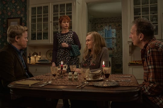 """Jessie Buckley (standing) plays a young woman who has a very awkward dinner with her boyfriend (Jesse Plemons) and his parents (Toni Collette and David Thewlis) in """"I'm Thinking of Ending Things."""""""
