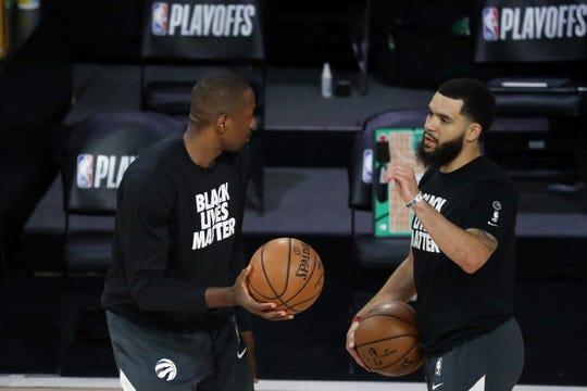 Raptors guard Fred VanVleet speaks with Toronto teammate Serge Ibaka prior to Tuesday's Game 2 against the Boston Celtics.