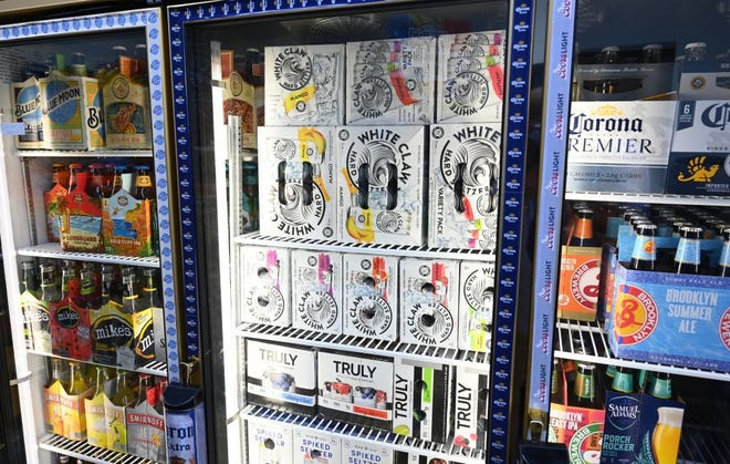 Cartons of hard seltzer are on display at the Round The Clock Deli Sept. 11, 2019 in New York City. Health-conscious Americans have found a new drink that tends to be lower in calories and carbs than beer and wine.