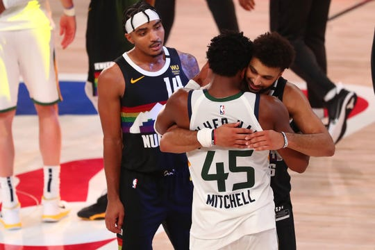 Denver Nuggets guard Jamal Murray and Utah Jazz guard Donovan Mitchell embrace after Game 7.
