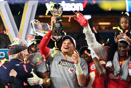 Chiefs quarterback Patrick Mahomes hoists the Vince Lombardi Trophy after defeating the 49ers in Super Bowl LIV at Hard Rock Stadium.