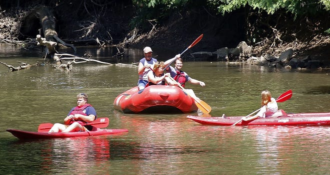 A group floats down the Mohican River in kayaks and a raft on Tuesday, June 30, 2020. Outdoor adventure has been a huge attraction during COVID-19, according to local visitors bureau's. Tom E. Puskar, Times-Gazette.com.