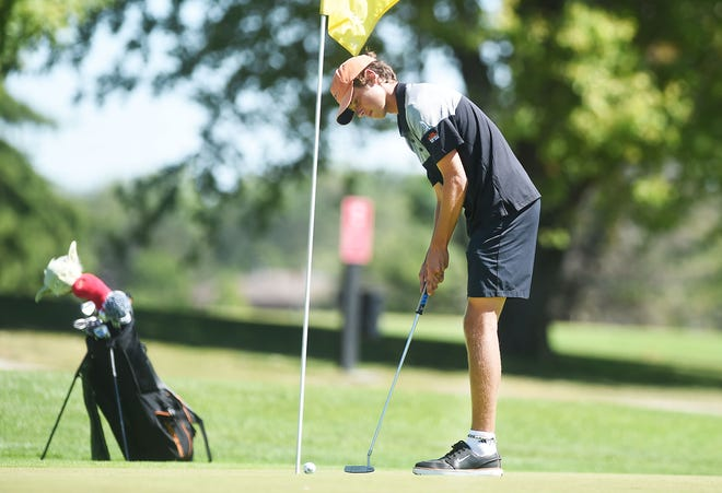 Ames senior Sam Vertanen, seen hear putting at home meet on the Veenker Memorial Golf Course earlier in the year, qualified for state individually Monday. Vertanen was medalist runner-up at the 4A district meet at the Whispering Creek Golf Club in Sioux City.