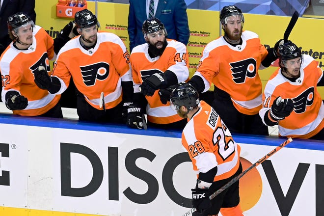 The Flyers' Claude Giroux is congratulated by his teammates after scoring a goal in the second period of Game 5 against the Islanders.