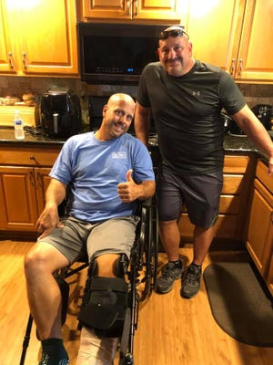 Falls police officer Jeffrey Rhodunda was injured in a crash on Aug. 22. He was released recently. Rhodunda, left, poses with his brother, Falls police officer Bruce Rhodunda.