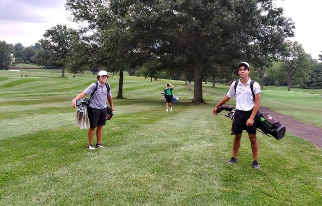 Central Bucks West's Alex Feraco (left) and Milo Jezzeny walk off the course at Indian Valley Country Club after a tornado warning forced the postponement of the Bucks' match against Pennridge.