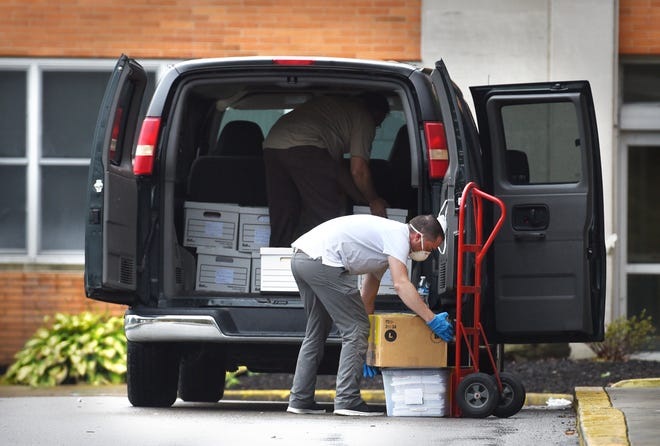 FBI agents seize boxes of files and documents during a court-issued federal search warrant Thursday morning at Brighton Rehabilitation and Wellness Center.