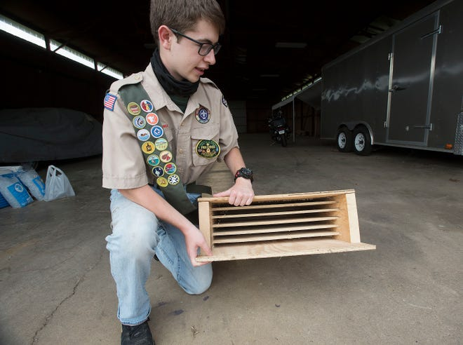 Pete West of Ohioville shows the inside of a large bat house with six chambers that can accommodate up to 300 bats and their pups. Building bat houses is his Eagle Scout project. This is one of four that will be placed at nearby state game lands as a sanctuary for bats.