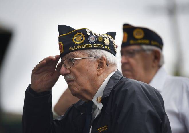 """Samuel Teolis, 93, salutes the Beaver and Lawrence County Honor Guard as they play """"Taps"""" during a ceremony marking the 75th anniversary of the end of the war with Japan. The American Legion Post 57 laid a wreath on the monument Wednesday morning at Legion Park in Ellwood City. [Sally Maxson/For ECL]"""