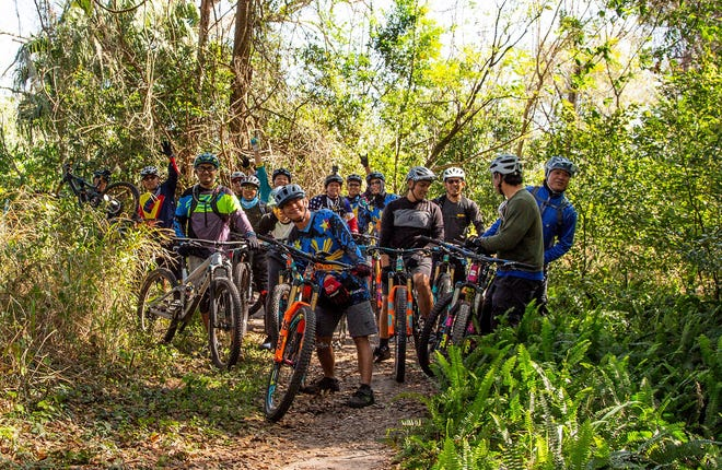 A group from the Ocala Mountain Bike Association ride some of the trails in Lake County. [Submitted]