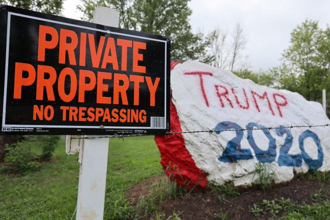 "A boulder — about 5-feet high and twice as long — painted red, white and blue with the slogan ""Trump 2020"" is the talk of a rural Ohio community."