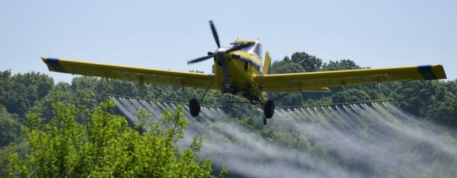 A plane from Fisher Ag Services sprays cover crop seeds. Fisher Ag Services will be seeding Holmes County on Tuesday, Sept. 8.