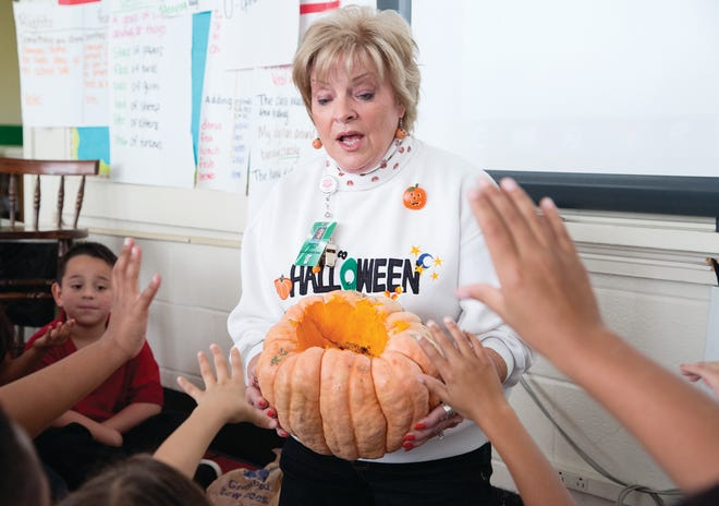 Mrs. Mattie King leads a course on carving pumpkins at McDowell Elementary School in October 2015.