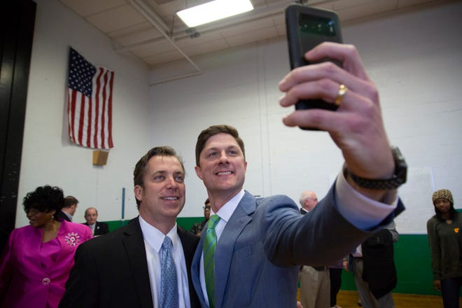 Maury County Mayor Andy Ogles and Columbia Mayor Chaz Molder take a selfie at McDowell Elementary School after Molder was ceremoniously sworn in to office at the school on Thursday, Jan. 10, 2019.