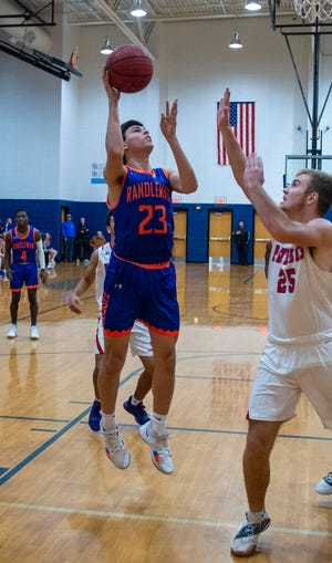 Randleman's Nate Cassidy shoots against Providence Grove in their first game of the 2019-2020 season at PGHS on December 10, 2019.