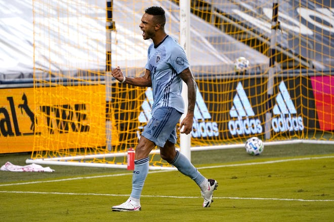 Sporting Kansas City forward Khiry Shelton celebrates after scoring a goal during first half stoppage time in Wednesday's match against FC Dallas at Children's Mercy Park. Sporting and Dallas tied 1-1.
