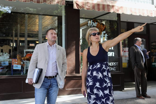 Sara Hecox, grant administrator with Southeast Iowa Regional Planning Commission, points out some of the downtown facade projects to Jason Mohr, regional administrator for the Great Plains Region of the U.S. Department of Housing and Urban Development, Wednesday in downtown Burlington following Mohr's meeting at City Hall with several city officials.