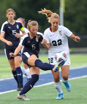 In this file photo, Twinsburg defender Paige Hepke boots the ball. Twinsburg beat Hathaway Brown 4-1 this weekend.
