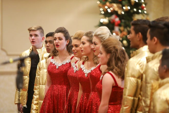 "Members of Twinsburg High School's show choir ""Great Expectations"" perform a selection of holiday tunes at the Twinsburg Chamber of Commerce's annual Business Person of the Year award luncheon last year. This year's holiday concerts sponsored by the school will be prerecorded and shown virtually."