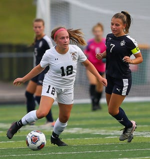 Cuyahoga Falls' Sonia Hammonds brings the ball ahead of Twinsburg captain Sammi Dimuzio during the Black Tigers' 3-0 loss at Twinsburg Tiger Stadium Sept. 2.