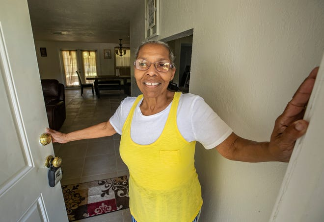 Step It Up Ministries CEO and founder Maxine Dooley opens the door to a new women's safe house in Lakeland. The home on East Parker Street will house five women. ERNST PETERS/THE LEDGER