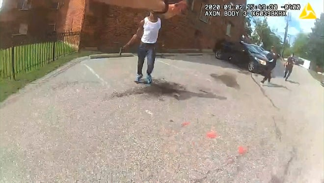 This image from video released by the Metropolitan Police Department, shows body cam video during a foot pursuit with Deon Kay, center, in Washington, on Wednesday afternoon. Police in the nation's capital released body camera footage from the officer who fatally shot the Black 18-year-old in the chest. METROPOLITAN POLICE DEPARTMENT via AP