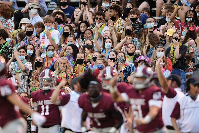 The Oak Ridge fan section  cheers during a football game between Oak Ridge and Dobyns-Bennett at Oak Ridge in Oak Ridge, Tenn., on Saturday, Aug. 29, 2020. Principal Martin McDonald said he was 'frustrated' with some spectators taking off their masks at the game after they got through the gate.