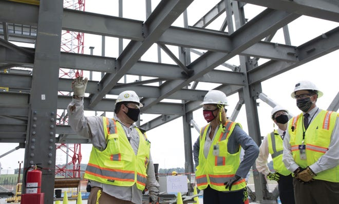 Brett Riffert, left, a superintendent on the Uranium Processing Facility construction, updates NNSA Administrator Lisa E. Gordon-Hagerty on the its progress at Y-12 National Security Complex.