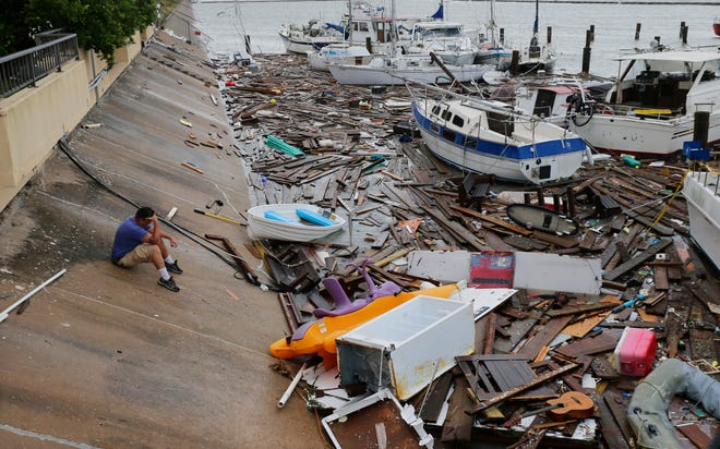 A man surveys the damage to a marina after it was hit by Hurricane Hanna on July 26, 2020, in Corpus Christi, Texas.