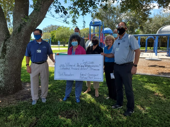 Congresswoman Lois Frankel (second from left) held a news conference in Palm Springs to announce $600,000 in federal grants for Palm Springs and Wellington to improve parks.