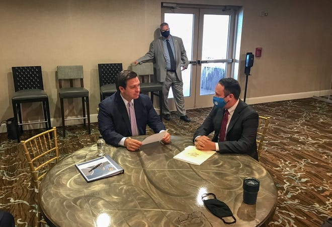 Gov. Ron DeSantis meets with Palm Beach County Mayor Dave Kerner at the the 2020 National Fraternal Order of Police Fall Board Meeting in Atlantic Beach. [Photo: Palm Beach County]