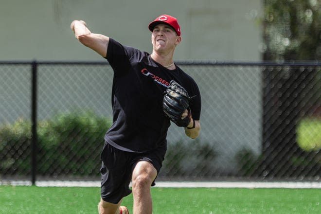 Spencer Stockton, a former Wellington High pitcher, loosens up Thursday at Cressey Sports Performance in Palm Beach Gardens. Stockton, a member of the Reds organization, played in the Class A Midwest League in 2019.