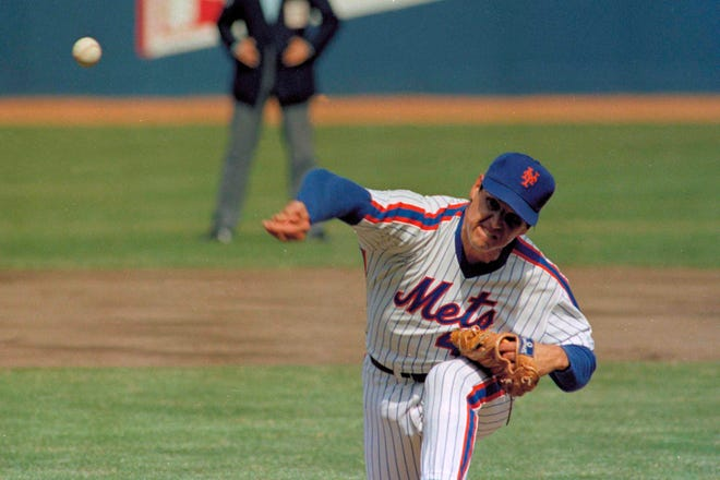 In this April 5, 1983, file photo, New York Mets pitcher Tom Seaver throws against the Philadelphia Phillies on Opening Day at Shea Stadium in New York. Seaver died Monday at the age of 75.