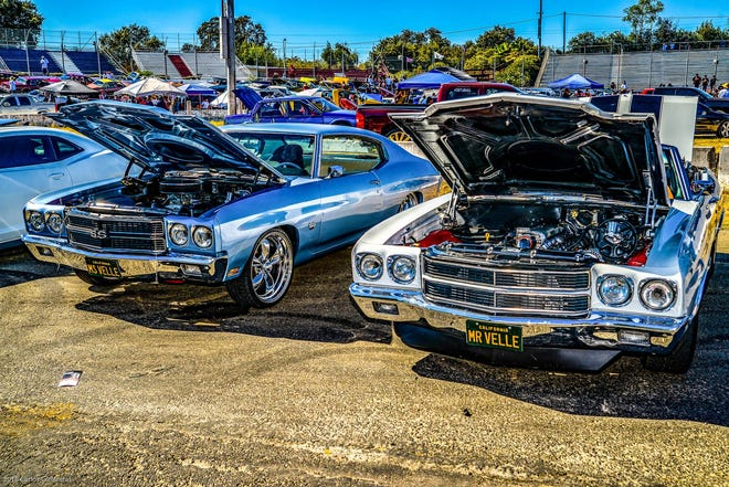 A pair of Chevrolet Chevelles are displayed at a past car show at Stockton 99 Speedway.