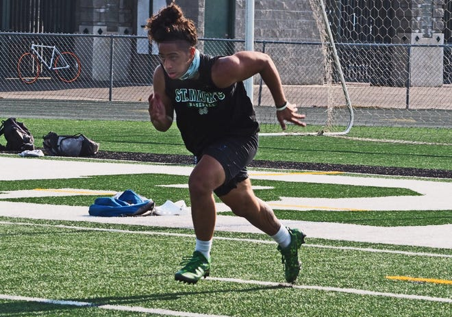 St Mary's senior linebacker Izaiah Aponte runs sprints during a summer workout Wednesday at St. Mary's High School in Stockton.