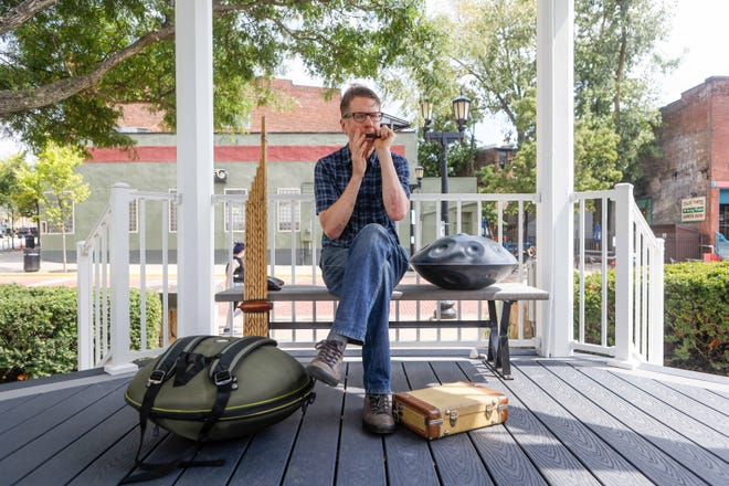 Musician Hal Walker surrounded by some of the instruments he is known for playing on the social media app TikTok. Walker and his unique instruments have helped him garner a following of over 200,000 on the social media app, TikTok.