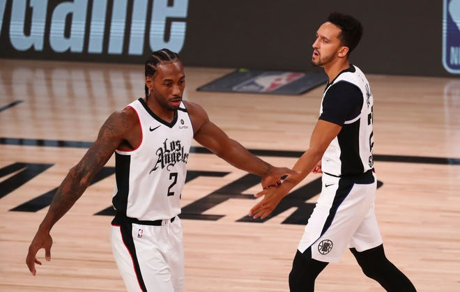 Kawhi Leonard (2), Landry Shamet and the Los Angeles Clippers meet the Denver Nuggets on Thursday night in the opening game of their Western Conference semifinal playoff series. (Kim Klement/Pool Photo via AP)