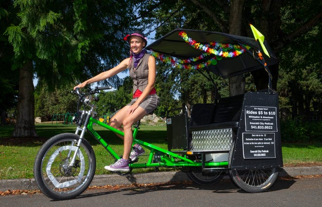 Ashley Wright — musician, bike taxi driver and fixture around town — keeps peddling despite the challenges of a pandemic.