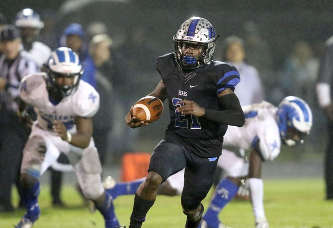Bartram Trail running back Eric Weatherly (21) takes off for a long run in the second quarter against Apopka during a Region 1-8A semifinal on Nov. 15, 2019.