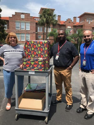 Cindee Wade, a member of the Veterans of Foreign Wars Auxiliary Post 2391, delivers school supplies to Children's Services.