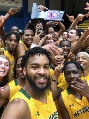 Methodist men's basketball players celebrate their USA South tournament championship win over Huntingdon on Feb. 29, 2020, in Danville, Va.