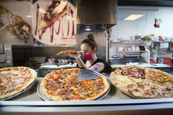 Slice of Italy has opened in the Eutaw Shopping Center.