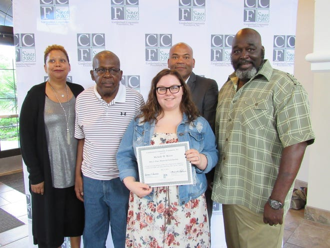 Seventy-First High School graduate Michelle Morris is the first recipient of the Rita J. Pope Memorial Scholarship. With her are Pope's daughter, Millita Billups-Robinson; Melvin Jennings; and Pope's sons, Jeri Coleman and Kerri Coleman.