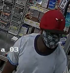 Security video captured a man wanted in a gas station robbery on Murchison Road.