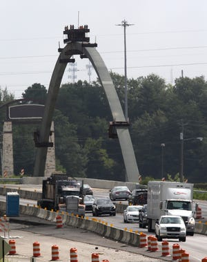 The first of two arches erected on the Interstate overpass at McFarland Blvd. is seen Thursday, Sept. 3, 2020. The arch is going to have to be replaced due to a problem, state road officials have confirmed. [Staff Photo/Gary Cosby Jr.]