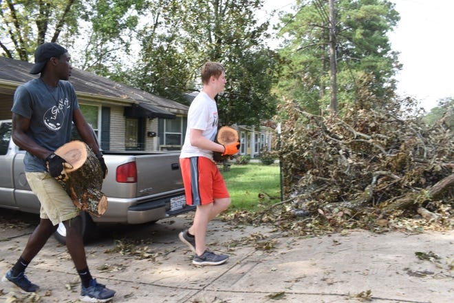 Family of Grace youth members were busy Wednesday, Sept. 2, 2020 helping those in the community clean up debris from Hurricane Laura. Lance Cypert, multiplying pastor at the church, said the youth wanted to help out and they had five homes that they were helping to clean up.