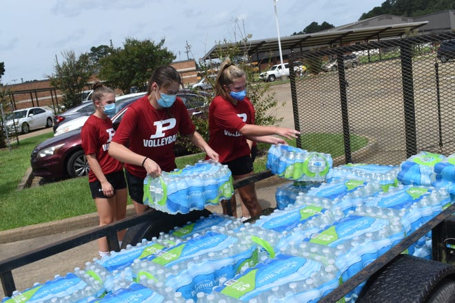 The Pineville High School volleyball team passed out free water, ice and snow cones to the community after Hurricane Laura. The storm has altered the district's calendar and delayed classes after an earlier delay because of the COVID-19 pandemic.