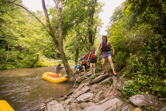 Jump Off Rock on the Nantahala River in Swain County can be accessed by a pull-off on U.S. 74 or on a raft trip with the Nantahala Outdoor Center.