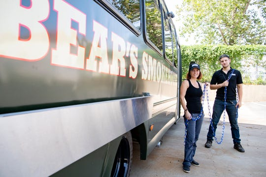 "Cheryl Antoncic and her son, Collyn McDonald, stand outside of their future Bear's Smokehouse Barbecue food truck with a chain of ""Linked 4 Life"" carabiners on Sept. 3, 2020. The carabiners are being sold for donations that promote the destigmatization of needing help with mental health and benefit suicide prevention programs. They are seeking to break a world record for the longest chain of carabiners at a Connecticut event on Mental Health Awareness day, October 10."