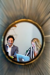 Reflected in a mirror, couple Kelly Denson and Rich Brownstein are both leaning in to careers in real estate as they adjust to changes brought on by COVID-19. Denson had primarily been working in event planning and Brownstein, while already selling real estate, was also performing in a band. The two are now starting their own real estate company, Skylark Realty Group. Photographed at their home, which is also their current office on Sept. 1, 2020.
